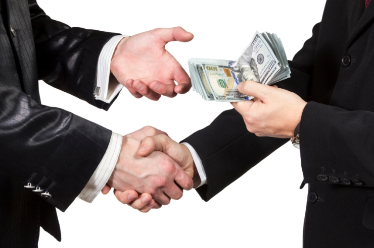 Handshake with the transfer of money